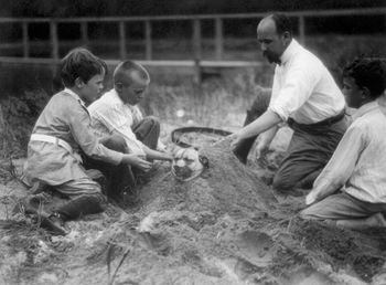 Digital Photo of a Family Burying a Patient Dog in the Sand #H39AC1FoPUs
