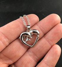 Shiny Silver Tone Dolphin Pair Forming a Heart Pendant #32u04c7L4ug