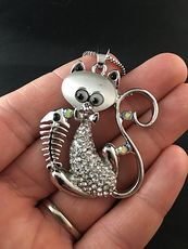 Sitting Kitty Cat with Rhinestones and a Fish Bone Pendant #GLCikV7KeQc
